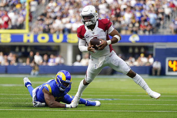 Arizona Cardinals quarterback Kyler Murray evades the tackle attempt from Los Angeles Rams linebacker Obo Okoronkwo during the first half in an NFL football game Sunday, Oct. 3, 2021, in Inglewood, Calif. (AP Photo/Ashley Landis)