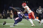 A pass to New England Patriots wide receiver Phillip Dorsett, left, falls incomplete as Kansas City Chiefs cornerback Charvarius Ward interferes in the first half of an NFL football game, Sunday, Dec. 8, 2019, in Foxborough, Mass. Ward was penalized for pass interference. (AP Photo/Elise Amendola)