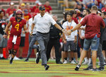 Iowa State head coach Matt Campbell, center, runs on the field and high fives fans before an NCAA college football game against South Dakota State , Saturday, Sept. 1, 2018, in Ames, Iowa. (AP Photo/Matthew Putney)