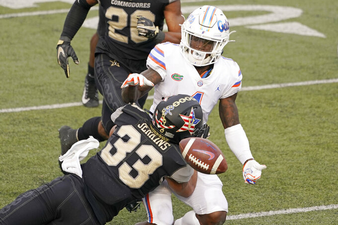 Vanderbilt safety Dashaun Jerkins (33) knocks the ball loose from the grasp of Florida wide receiver Kadarius Toney (1) in the second half of an NCAA college football game Saturday, Nov. 21, 2020, in Nashville, Tenn. Vanderbilt recovered the ball on the play. (AP Photo/Mark Humphrey)