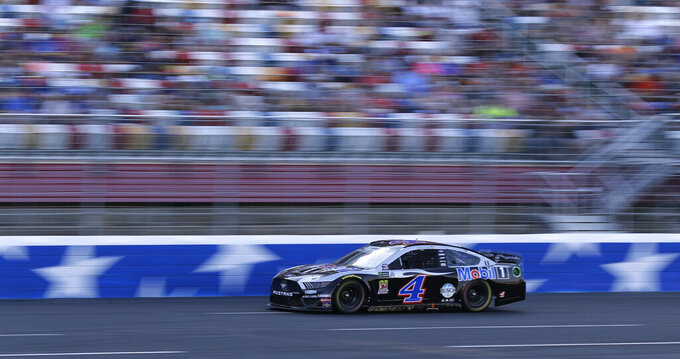 Kevin Harvick (4) drives during a NASCAR Cup Series auto race at Charlotte Motor Speedway in Concord, N.C., Sunday, May 26, 2019. (AP Photo/Chuck Burton)