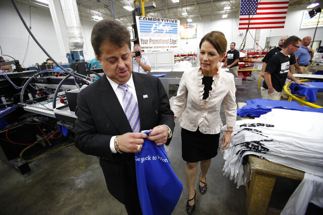 FILE - In this Aug. 10, 2011, file photo, U.S. Rep. Michele Bachmann, R-Minn., tours the Competitive Edge plant with president David Greenspon during a campaign stop, in Clive, Iowa. A judge ordered probation Wednesday, July 8, 2020, for Greenspon, a well-known Iowa businessman with deep ties to the Republican Party, saying he failed to show genuine remorse for assaulting a woman at his home last year. Judge Michael Huppert rejected a request by Greenspon for a deferred judgment in the assault, which occurred at Greenspon's West Des Moines mansion last November. (AP Photo/Charlie Neibergall File)