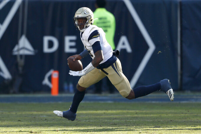 Georgia Tech quarterback James Graham (4) scrambles as he looks for an open receiver in the first half of an NCAA football game against the Virginia Tech Saturday, Nov. 16, 2019, in Atlanta. (AP Photo/John Bazemore)