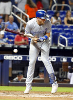Kansas City Royals' Hunter Dozier reacts to a close pitch during the fourth inning of a baseball game against the Miami Marlins, Friday, Sept. 6, 2019, in Miami. (AP Photo/Wilfredo Lee)