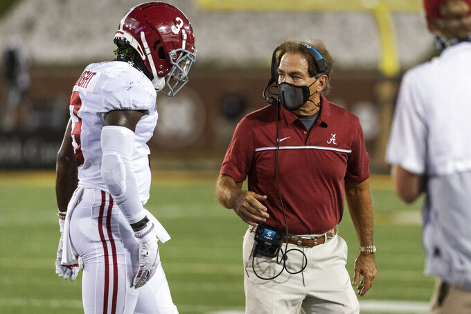 Alabama head coach Nick Saban, right, talks with Daniel Wright as he walks off the field during the second half of an NCAA college football game against Missouri, Saturday, Sept. 26, 2020, in Columbia, Mo. (AP Photo/L.G. Patterson)