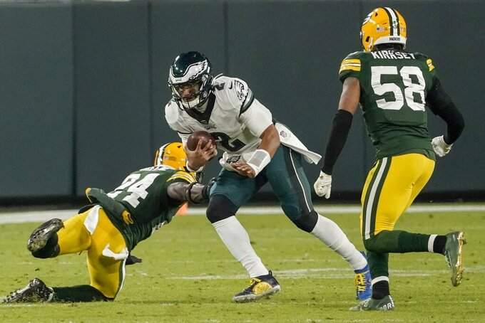 Philadelphia Eagles' Jalen Hurts runs during the second half of an NFL football game against the Green Bay Packers Sunday, Dec. 6, 2020, in Green Bay, Wis. (AP Photo/Morry Gash)