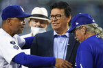 Former Los Angeles Dodgers pitcher Fernando Valenzuela, center, greets Dodgers manager Dave Roberts, left, during a ceremony honoring Valenzuela before a baseball game between the Arizona Diamondbacks and the Los Angeles Dodgers Wednesday, Sept. 15, 2021, in Los Angeles. (AP Photo/Ashley Landis)