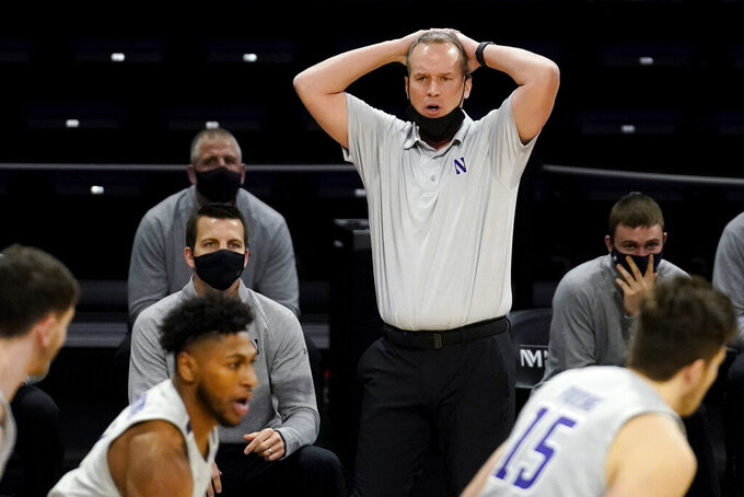 Northwestern head coach Chris Collins reacts as he watches his team during the first half of an NCAA college basketball game against Wisconsin in Evanston, Ill., Saturday, Feb. 21, 2021. (AP Photo/Nam Y. Huh)