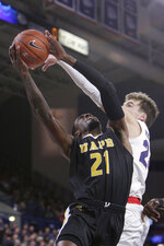 Arkansas-Pine Bluff guard Shaun Doss, left, is fouled by Gonzaga forward Corey Kispert during the first half of an NCAA college basketball game in Spokane, Wash., Saturday, Nov. 9, 2019. (AP Photo/Young Kwak)