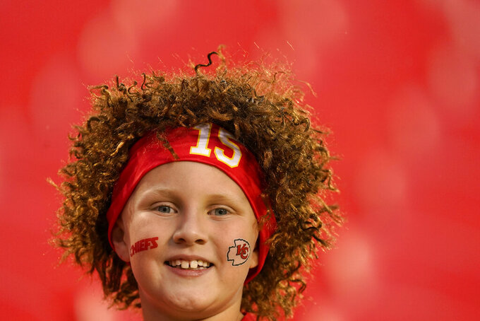 A Kansas City Chiefs fan is seen before the start of an NFL football game between the Kansas City Chiefs and the Buffalo Bills Sunday, Oct. 10, 2021, in Kansas City, Mo. (AP Photo/Charlie Riedel)