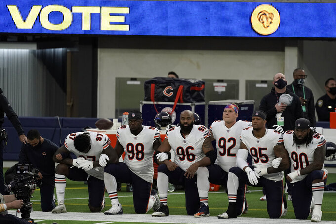 Members of the Chicago Bears kneel during the national anthem before an NFL football game against the Los Angeles Rams Monday, Oct. 26, 2020, in Inglewood, Calif. (AP Photo/Ashley Landis)
