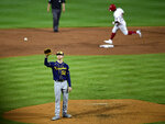 Milwaukee Brewers starting pitcher Eric Lauer receives a new ball after giving up a home run to Philadelphia Phillies' Andrew McCutchen during the third inning of a baseball game, Tuesday, May 4, 2021, in Philadelphia. (AP Photo/Derik Hamilton)