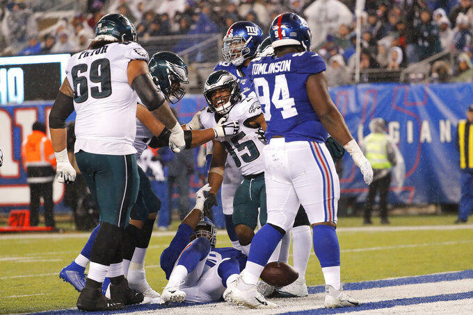 Philadelphia Eagles running back Boston Scott (35) celebrates a touchdown with teammates in the second half of an NFL football game against the New York Giants, Sunday, Dec. 29, 2019, in East Rutherford, N.J. (AP Photo/Seth Wenig)