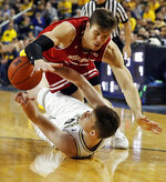 Wisconsin forward Ethan Happ, top, and Michigan center Jon Teske (15) chase after a loose ball during the first half of an NCAA college basketball game, Saturday, Feb. 9, 2019, in Ann Arbor, Mich. (AP Photo/Carlos Osorio)