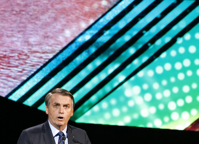 Brazilian President Jair Bolsonaro speaks during the Future Investment Initiative forum in Riyadh, Saudi Arabia, Wednesday, Oct. 30, 2019. Bolsonaro has launched a fiery defense of his far-right government while on a visit to Saudi Arabia, blasting any criticism of his policies on recent fires in the Amazon region. (AP Photo/Amr Nabil)