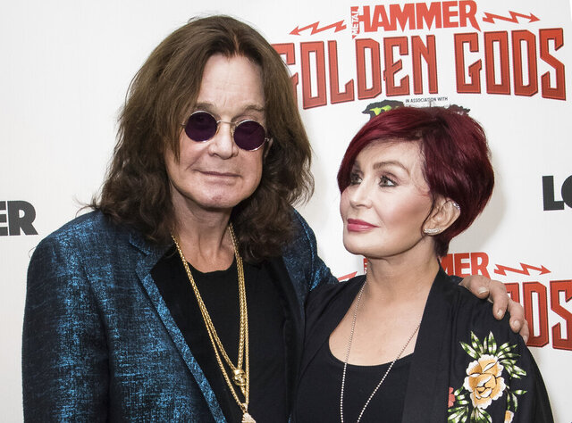 "FILE - This June 11, 2018 file photo shows musician Ozzy Osbourne, left, and his wife Sharon Osbourne at the Metal Hammer Golden God awards in London. The 71-year-old Grammy winner and former vocalist for the metal band Black Sabbath said during an interview on ""Good Morning America"" that aired Tuesday, Jan. 21, 2020, that he's been diagnosed with Parkinson's disease, a nervous system disorder that affects movement.  The diagnosis came after a fall last year.  (Photo by Vianney Le Caer/Invision/AP, File)"