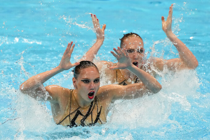 Svetlana Kolesnichenko and Svetlana Romashina of Russian Olympic Committee compete in the Free Routine Final at the 2020 Summer Olympics, Wednesday, Aug. 4, 2021, in Tokyo, Japan. (AP Photo/Dmitri Lovetsky)