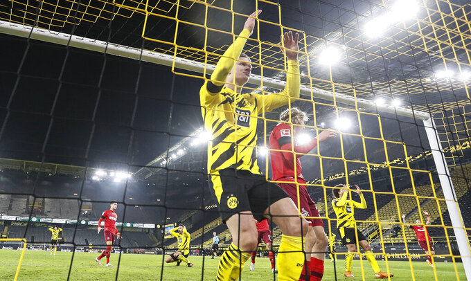 Dortmund's Erling Haaland reacts in the goal after he missed to score in the last minute of the German Bundesliga soccer match between Borussia Dortmund and 1.FC Cologne in Dortmund, Germany, Saturday, Nov. 28, 2020. Dortmund was defeated 1-2. (AP Photo/Martin Meissner, Pool)