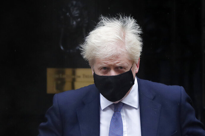 Britain's Prime Minister Boris Johnson leaves Downing Street to attend the weekly session of Prime Ministers Questions at Parliament in London, Wednesday, Oct. 21, 2020. The European Union is taking a defiant tone as the standoff over resuming post-Brexit trade negotiations with the United Kingdom continues. The bloc told London Wednesday that