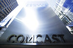 FILE - This March 29, 2017, file photo shows a sign outside the Comcast Center in Philadelphia.  The potential for another media megadeal are sending shares of Comcast, Twenty-First Century Fox and Disney into motion before the opening bell. After a judge cleared AT&T's $85 billion takeover of Time Warner on Tuesday, June 12, 2018, many now expect Comcast to top Disney's pending $52.4 billion stock offer for the entertainment assets of Twenty-First Century Fox, possibly as early as Wednesday.  (AP Photo/Matt Rourke, File)