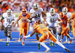 Colorado State running back Izzy Matthews (24) tries to hurdle Boise State safety Tyreque Jones (21) in the first half of an NCAA college football game, Friday, Oct. 19, 2018, in Boise, Idaho. (AP Photo/Steve Conner)