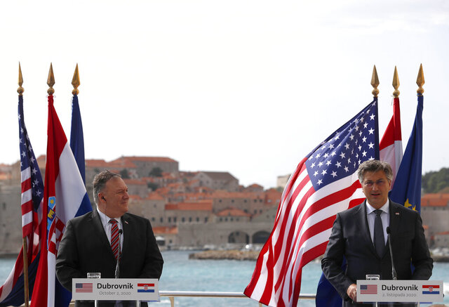 U.S. Secretary of State Mike Pompeo, left, listens as Croatia's Prime Minister Andrej Plenkovic speaks during a joint press conference in Dubrovnik, Croatia, Friday, Oct. 2, 2020. Pompeo is in Croatia as part of his six-day trip to Southern Europe. (AP Photo/Darko Bandic, Pool)