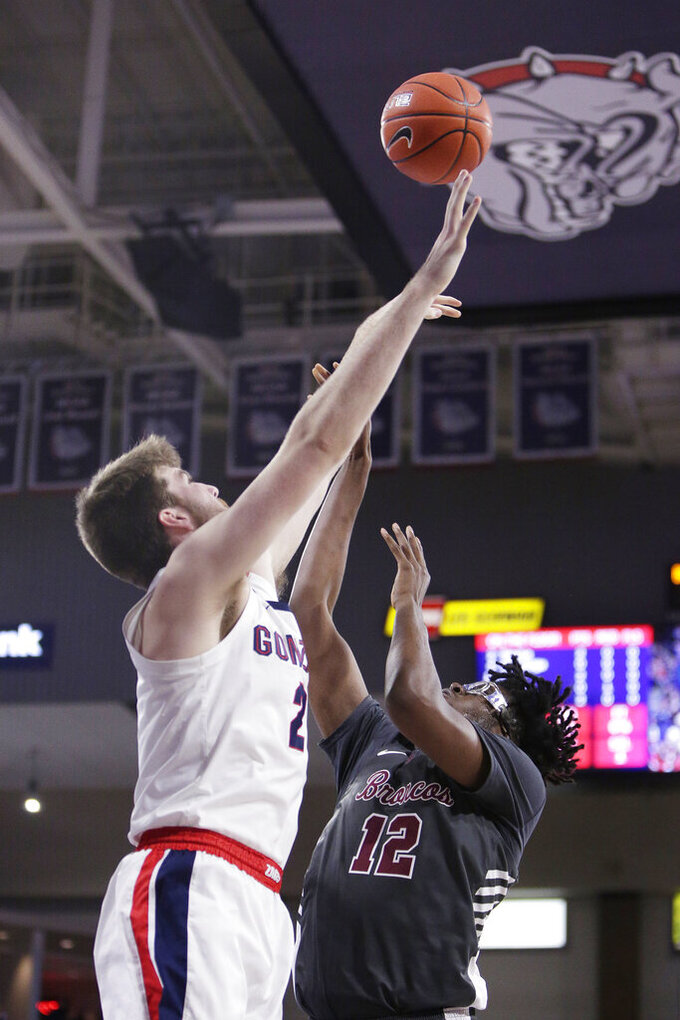 Gonzaga forward Drew Timme (2) blocks a shot by Santa Clara center Jaden Bediako (12) during the first half of an NCAA college basketball game in Spokane, Wash., Thursday, Jan. 16, 2020. (AP Photo/Young Kwak)