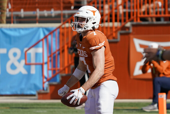 Texas' Jake Smith (7) reacts after his touchdown catch against West Virginia during the second half of an NCAA college football game in Austin, Texas, Saturday, Nov. 7, 2020. (AP Photo/Chuck Burton)