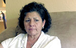 FILE- In this July 14, 2015, file image from video, Tina Cordova talks of her late father, Anastacio Cordova, in her Albuquerque, N.M., home. Cordova believes her father, who died in 2013 after suffering from multiple bouts of cancer, was affected by the atomic bomb Trinity Test in New Mexico since he lived in nearby Tularosa, N.M. as a child. The Western Governors' Association said Friday, Oct. 11, 2019, atmospheric nuclear weapons testing exposed more states and more people to radiation fallout and resulting cancers and other diseases than the federal government recognizes. (AP Photo/Russell Contreras, File)