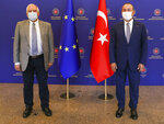 Turkey's Foreign Minister Mevlut Cavusoglu, right, and Josep Borrell Fontelles, High Representativeand Vice-Presidentof the European Commission, pose for photos before a meeting, in Ankara, Turkey, Monday, July 6, 2020.  Cavusoglu and Borrell has discussed Turkey-EU relations, regional issues, Libya and Syria. (Cem Ozdel/Turkish Foreign Ministry via AP, Pool)