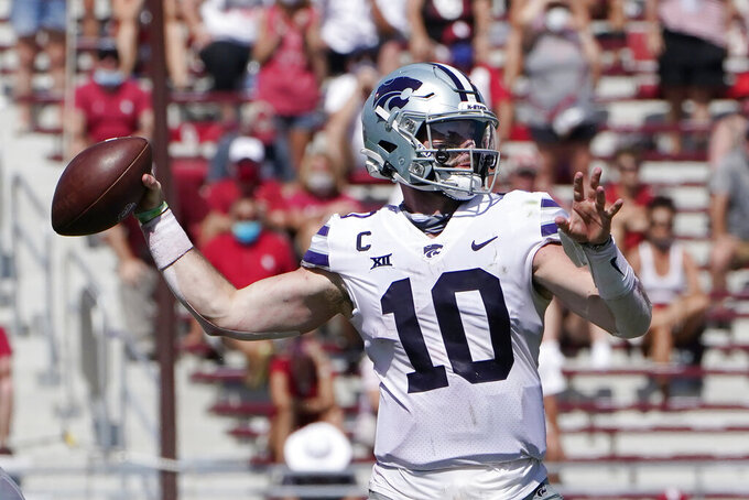 Kansas State quarterback Skylar Thompson (10) passes in the second half of an NCAA college football game against Oklahoma, Saturday, Sept. 26, 2020, in Norman, Okla. (AP Photo/Sue Ogrocki).
