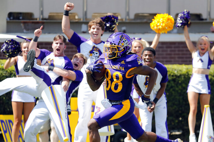 East Carolina's Jsi Hatfield (88) carries the ball for a touchdown against the South Carolina during the first half of an NCAA college football game in Greenville, N.C., Saturday, Sept. 11, 2021. (AP Photo/Karl B DeBlaker)