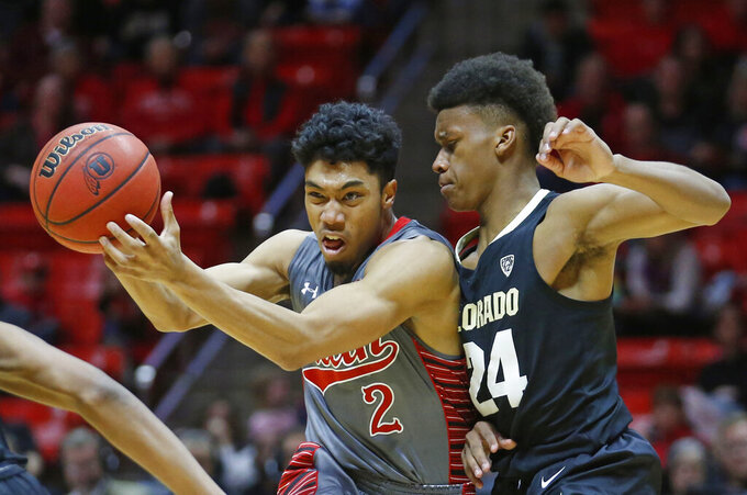 Colorado guard Eli Parquet (24) guards Utah guard Sedrick Barefield (2) during the second half of an NCAA college basketball game Sunday, Jan. 20, 2019, in Salt lake City. (AP Photo/Rick Bowmer)