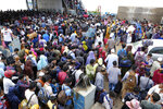 Thousands of people leaving for their native places to celebrate Eid-al-Fitr crowd the Mawa ferry terminal ignoring risks of coronavirus infection in Munshiganj, Bangladesh, Thursday, May 13, 2021. (AP Photo/Mahmud Hossain Opu)