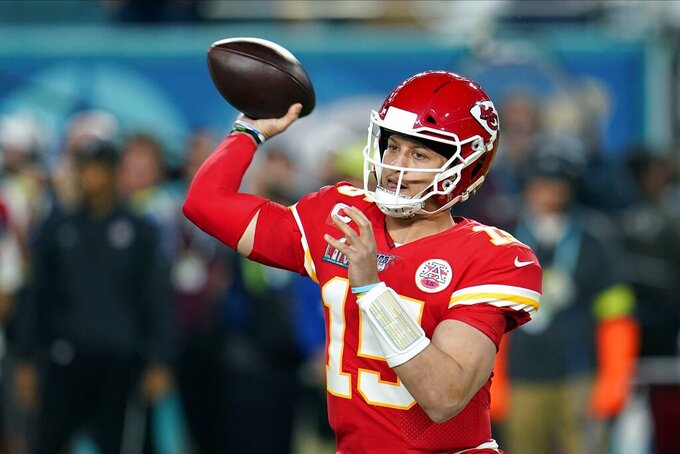 Kansas City Chiefs quarterback Patrick Mahomes passes against the San Francisco 49ers during the first half of the NFL Super Bowl 54 football game Sunday, Feb. 2, 2020, in Miami Gardens, Fla. (AP Photo/David J. Phillip)