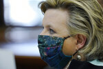 State Sen. Nicole Akins Boyd, R-Oxford, wears a floral face mask at a Senate Education Committee meeting with the State Superintendent of the Mississippi Department of Education Carey Wright at the Capitol in Jackson, Miss., Jan. 6, 2021. Lawmakers were generally masked throughout the hearing, removing or loosing the mask to speak clearly. (AP Photo/Rogelio V. Solis)
