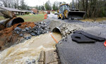 A road crew from Tuscaloosa County repairs a washed out section of New Orleans Drive in the Coker community which is in Tuscaloosa County west of the city of Tuscaloosa, Ala., Tuesday, Feb. 11, 2020. Heavy rains fell Monday leaving the Tuscaloosa area with high water and washed out roads. The National Weather Service says minor to moderate flooding is expected from central Mississippi to north Georgia following downpours. (Gary Cosby Jr./The Tuscaloosa News via AP)