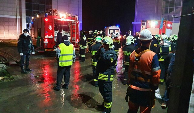 Emergency situation employees gather during a fire at a retirement home, housing elderly people with limited mobility, in Moscow, Russia, Thursday, April 9, 2020. A fire in a retirement home in Moscow killed around four people and injured more then ten others, but firefighters managed to rescue 50 people from the burning building, emergency officials said Thursday. (Kirill Voronin, Moscow News Agency photo via AP)