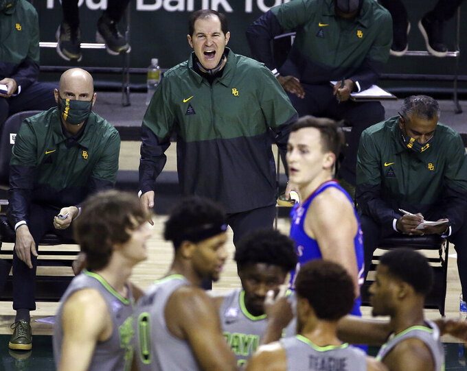 "File-Baylor head coach Scott Drew, top center, reacts to a play in the second half of an NCAA college basketball game against Kansas, Monday, Jan. 18, 2021, in Waco, Texas. ""You get to spend the entire year helping your game get better without the outside pressure or having to worry about being ready for each and every game, so it's truly one year of development,"" Drew said of redshirts, for current players and Bears in the past decade who went on to play professionally. (AP Photo/Jerry Larson, File)"