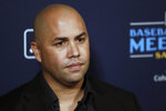 New York Mets manager Carlos Beltran listens to a question during the Major League Baseball winter meetings, Tuesday, Dec. 10, 2019, in San Diego. (AP Photo/Gregory Bull)