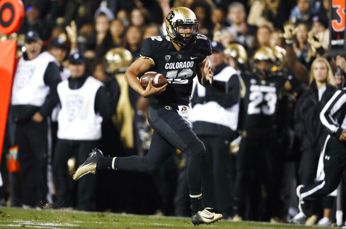 Colorado quarterback Steven Montez runs for a touchdown against UCLA during the second half of an NCAA college football game Friday, Sept. 28, 2018, in Boulder, Colo. Colorado won 38-16. (AP Photo/David Zalubowski)