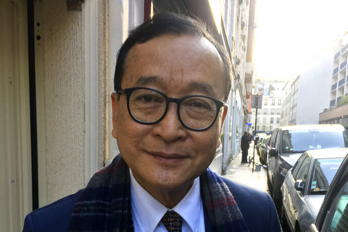 Cambodia's most prominent opposition politician Sam Rainsy, co-founder of the Cambodia National Rescue Party, poses in Paris, Thursday Nov.7, 2019 before heading to Paris airport and flying to Bangkok. Sam Rainsy said Tuesday he was ready to risk imprisonment or death by returning to his country from self-imposed exile to unseat the country's longtime ruler. (AP Photo/Nicolas Garriga)
