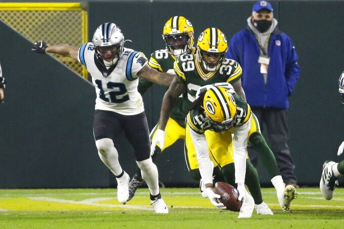 Green Bay Packers' Kevin King recovers a fumble in front of Carolina Panthers' D.J. Moore during the first half of an NFL football game Saturday, Dec. 19, 2020, in Green Bay, Wis. (AP Photo/Mike Roemer)