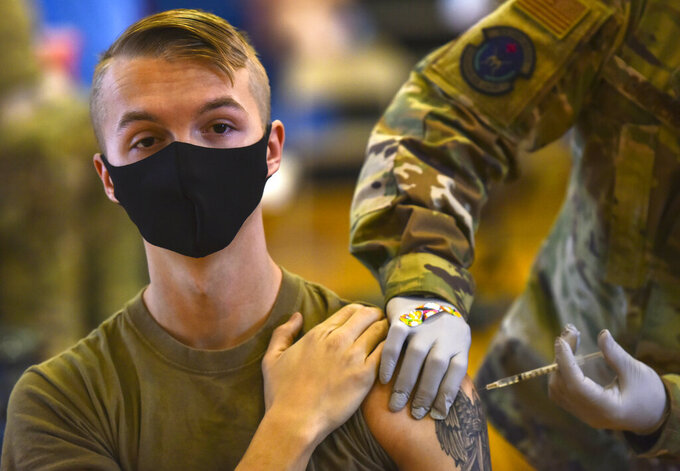 In this Feb. 9, 2021 photo provided by the Department of Defense, Hickam 15th Medical Group host the first COVID-19 mass vaccination on Joint Base Pearl Harbor-Hickam. By the thousands, U.S. service members are refusing or putting off the COVID-19 vaccine, as frustrated commanders scramble to knock down internet rumors and find the right pitch that will convince troops to take the shot. Some Army units are seeing as few as a third agree to the vaccine, others are higher. (U.S. Air Force Tech. Sgt. Anthony Nelson Jr./Department of Defense via AP)