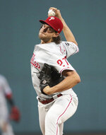 Philadelphia Phillies starting pitcher Aaron Nola delivers during the first inning of the team's baseball game against the Boston Red Sox at Fenway Park in Boston, Tuesday, Aug. 20, 2019. (AP Photo/Charles Krupa)