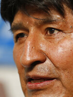 Former Bolivian President Evo Morales speaks during an interview with The Associated Press in Mexico City, Thursday, Nov. 14, 2019. Mexico granted asylum to Morales, who resigned on Nov. 10 under mounting pressure from the military and the public after his re-election victory triggered weeks of fraud allegations and deadly protests. (AP Photo/Eduardo Verdugo)