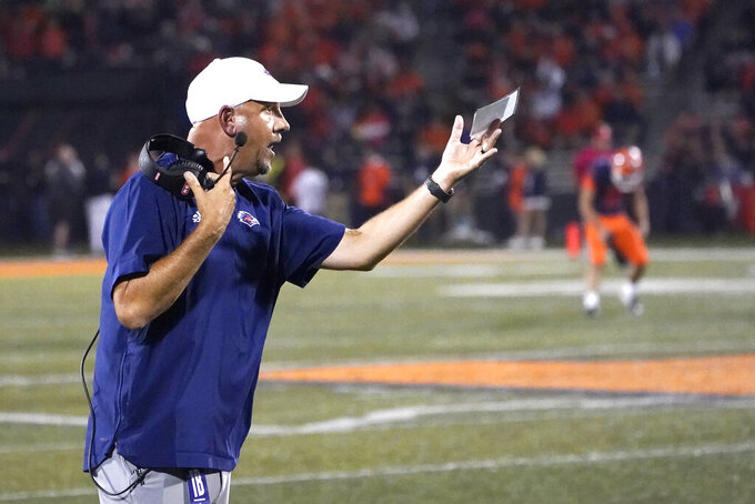UTSA head coach Jeff Taylor gestures during the first half of an NCAA college football game against Illinois, Saturday, Sept. 4, 2021, in Champaign, Ill. (AP Photo/Charles Rex Arbogast)