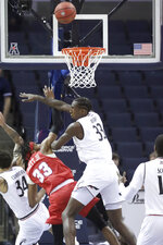 Cincinnati's Nyster Brooks blocks a shot attempt by SMU's Jimmy Whitt Jr. during the first half of an NCAA college basketball game at the American Athletic Conference men's tournament Friday, March 15, 2019, in Memphis, Tenn. (AP Photo/Troy Glasgow)