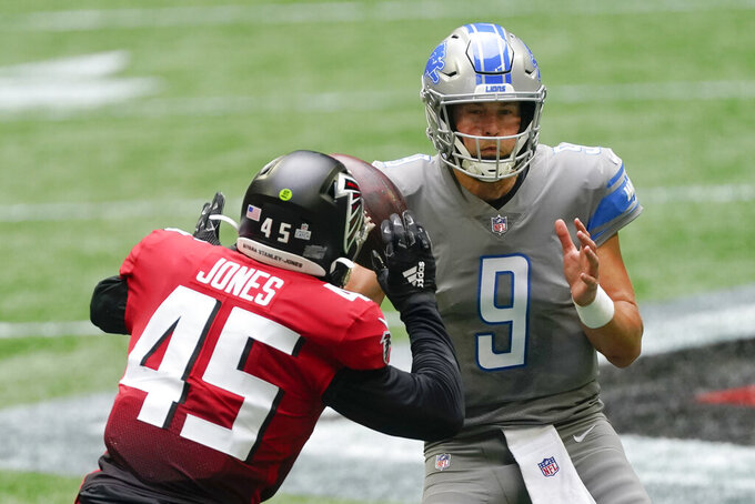 Atlanta Falcons linebacker Deion Jones (45) prepares to sack Detroit Lions quarterback Matthew Stafford (9) during the second half of an NFL football game, Sunday, Oct. 25, 2020, in Atlanta. (AP Photo/John Bazemore)