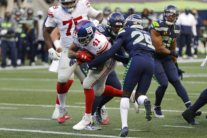 New York Giants running back Alfred Morris (41) gets past Seattle Seahawks free safety D.J. Reed (29) to rush for a touchdown during the second half of an NFL football game, Sunday, Dec. 6, 2020, in Seattle. (AP Photo/Larry Maurer)